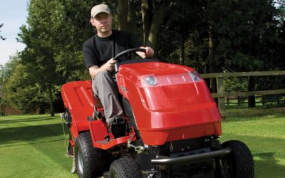 Man on a red lawnmower