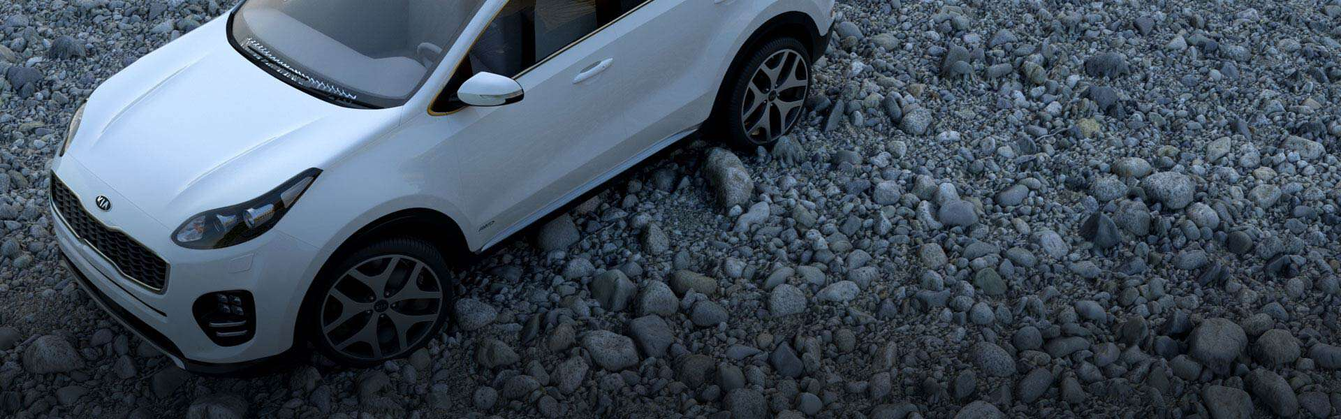 White Car on Pebbled Terrain