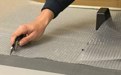Worker Cutting Bubble Wrap